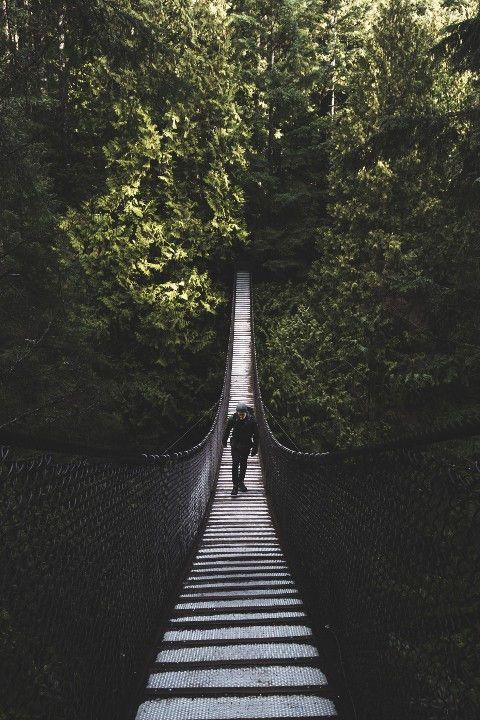 Man crossing a bridge