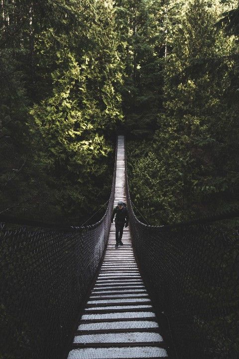 Man crossing a bridge